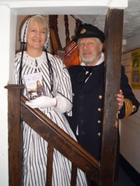 With husband Nigel in period naval costume.