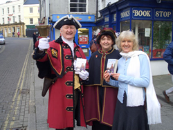 Outside the BookStop with Tavistock's Town Crier Bob Rose and his Lady Consort Shirley Rose.
